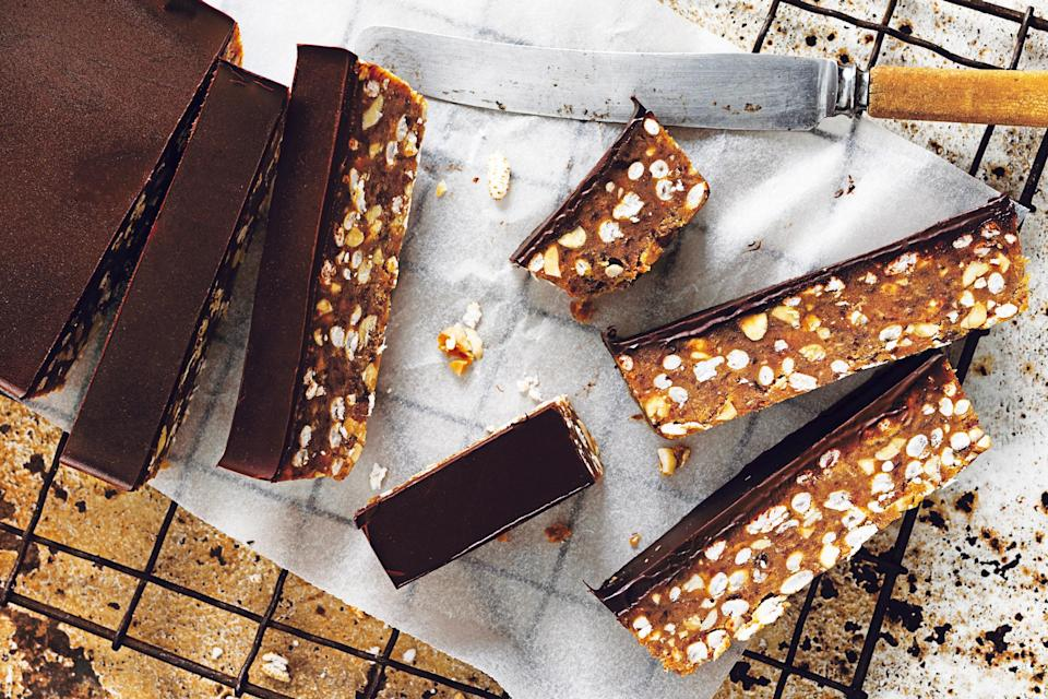 """Combine puréed dates, peanut butter, and puffed rice into these no-cook treats and gloss with a generous coating of chocolate for a (healthier-than-store-bought) candy bar whenever a craving strikes. <a href=""""https://www.epicurious.com/recipes/food/views/raw-caramel-peanut-crunch-bars?mbid=synd_yahoo_rss"""" rel=""""nofollow noopener"""" target=""""_blank"""" data-ylk=""""slk:See recipe."""" class=""""link rapid-noclick-resp"""">See recipe.</a>"""