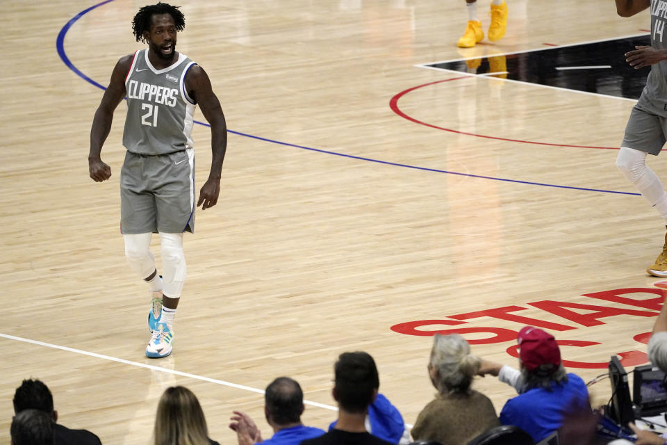 Los Angeles Clippers guard Patrick Beverley talks to fans during the second half in Game 4 of the NBA basketball Western Conference Finals against the Phoenix Suns Saturday, June 26, 2021, in Los Angeles. (AP Photo/Mark J. Terrill)
