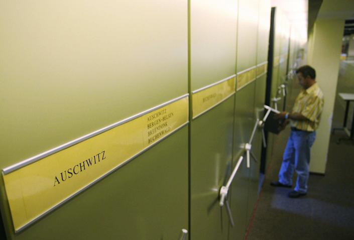 An employee of the International Tracing Service (ITS), an arm of the International Committee of the Red Cross and based in Bad Arolsen, works in a part of the ITS files department 28 July 2006. (MARTIN OESER/AFP/Getty Images)