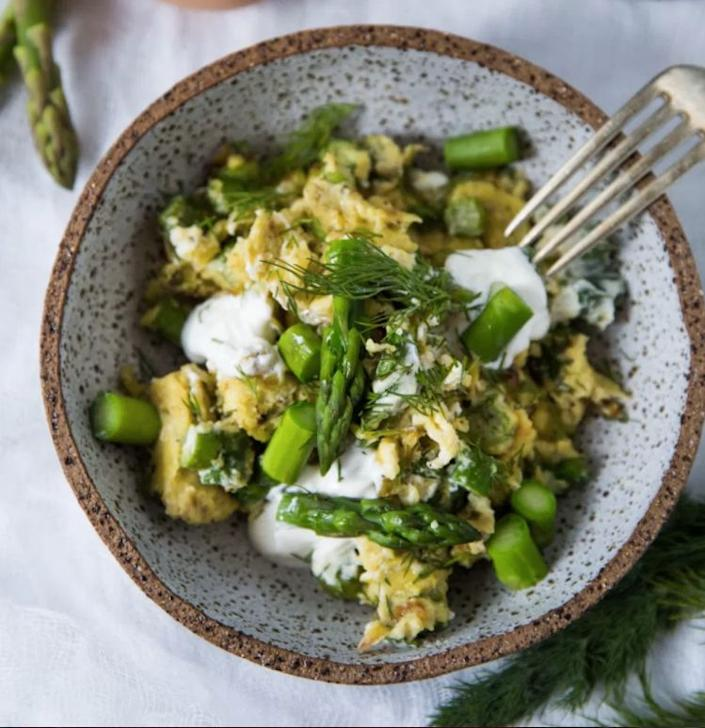 """<strong>Get the <a href=""""http://www.feastingathome.com/scrambled-eggs-with-asparagus-leeks-chevre-and-dill/"""" rel=""""nofollow noopener"""" target=""""_blank"""" data-ylk=""""slk:Scrambled Eggs With Asparagus, Leeks, Chevre And Dill recipe"""" class=""""link rapid-noclick-resp"""">Scrambled Eggs With Asparagus, Leeks, Chevre And Dill recipe</a>&nbsp;from Feasting at Home</strong>"""