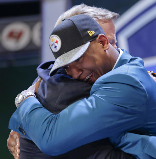 Ohio State outside linebacker Ryan Shazier hugs NFL commissioner Roger Goodell after being selected by the Pittsburgh Steelers as the 15th pick in the first round of the 2014 NFL Draft, Thursday, May 8, 2014, in New York. (AP Photo/Craig Ruttle)