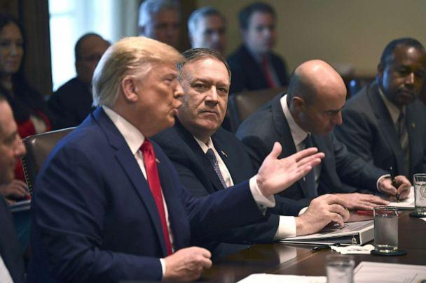 PHOTO: President Donald Trump speaks next to US Secretary of State Mike Pompeo during a Cabinet Meeting at the White House, Oct. 21, 2019. (Brendan Smialowski/AFP/Getty Images)