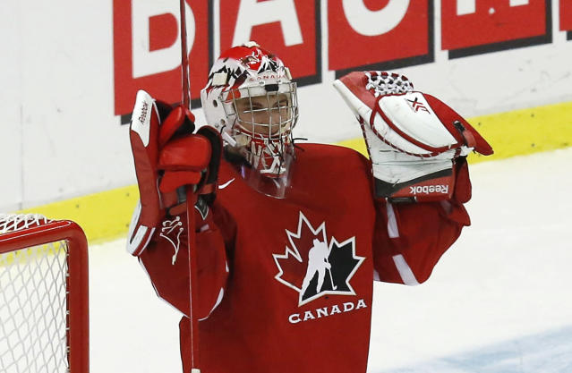 Canada's goalie Zachary Fucale raises his arms after Canada defeated the United States in their IIHF World Junior Championship ice hockey game in Malmo, Sweden, December 31, 2013. REUTERS/Alexander Demianchuk (SWEDEN - Tags: SPORT ICE HOCKEY)