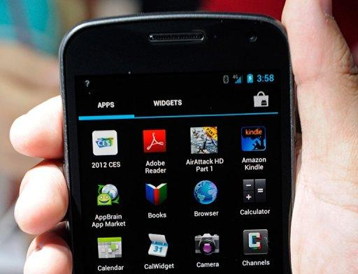 The Galaxy Nexus smarthphone is displayed at the Samsung booth at the 2012 International Consumer Electronics Show in Las Vegas. Google's Android system has grabbed more than 50 percent of the US smartphone market, while Samsung cemented its leadership as the top device maker, a survey showed Tuesday
