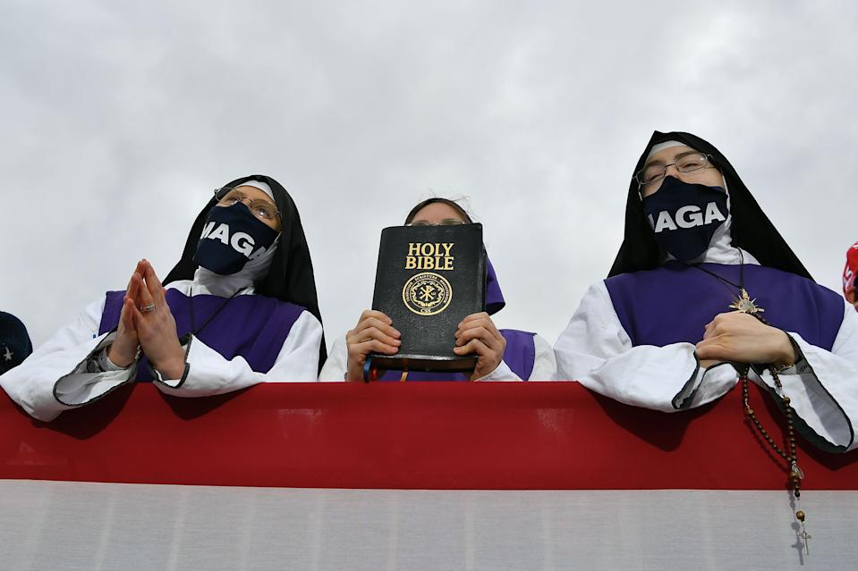 Nuns wearing masks displaying Donald Trump's MAGA slogan listen to the president during a campaign rally at Pickaway Agriculture and Event Center in Circleville, Ohio, on Oct. 24.