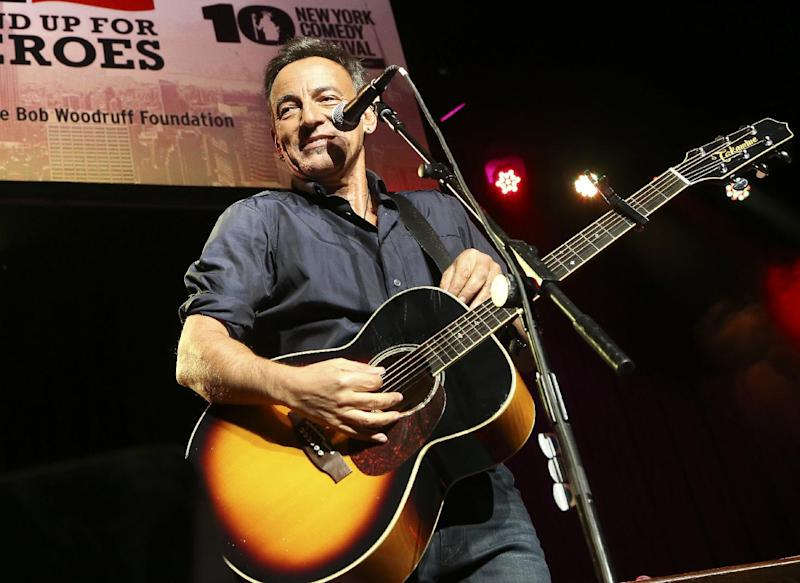 """FILE - In this Nov. 6, 2013 file photo, musician Bruce Springsteen performs at the Stand Up for Heroes event at Madison Square Garden, in New York. The Boss himself will close out three days of performances in Dallas that will keep NCAA Final Four fans rocking. Andrew Dost of the pop-rock trio fun., which will take the stage before Bruce Springsteen and the E Street Band on Sunday, April 6, 2014, says, """"I'm really excited just for the energy that will be in town, to be part of that energy."""" (John Minchillo/Invision/AP, file)"""
