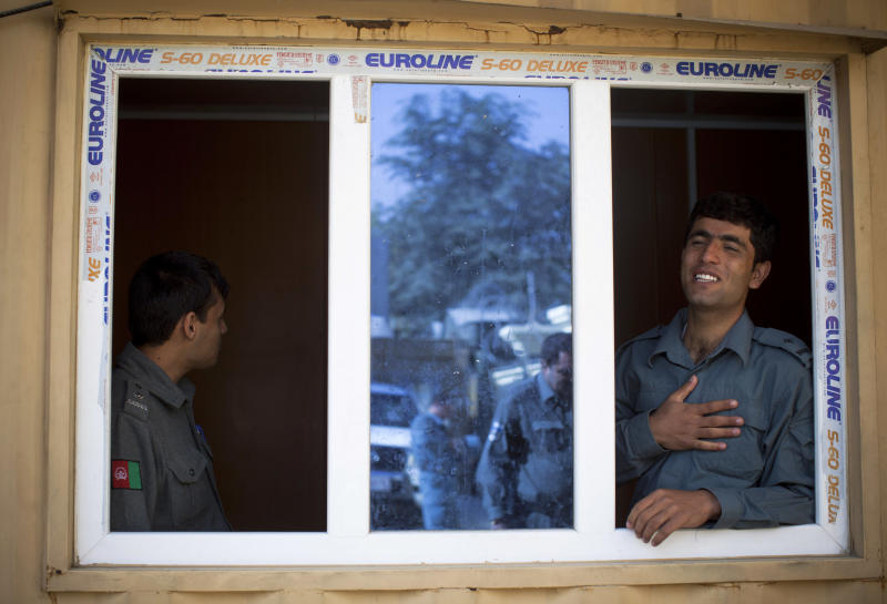 Afghan National Police officers waiting for new recruits at the Police registration office in Kabul, Afghanistan, Saturday, Oct. 13, 2012.  International observers worry that the Afghan police will not be able to maintain security after NATO and US troops withdrawal from Afghanistan in 2014.  (AP Photo/Anja Niedringhaus)