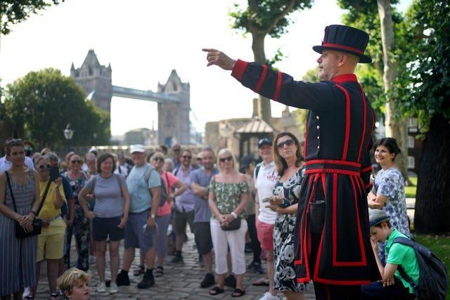 Yeoman Warder Barney Chandler leads a tour of the tower