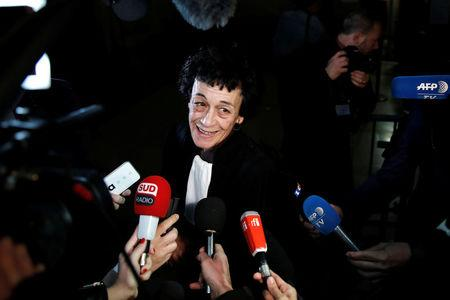 "Isabelle Coutant-Peyre, lawyer and wife of Ilich Ramirez Sanchez, known as ""Carlos the Jackal"",  talks to journalists at the courthouse before the opening of the Carlos' trial in Paris, France March 13, 2017. Carlos the Jackal is appearing in a Paris court for a deadly 1974 attack at a shopping arcade in the French capital, a trial that victims' families have been awaiting for decades.  REUTERS/Benoit Tessier"