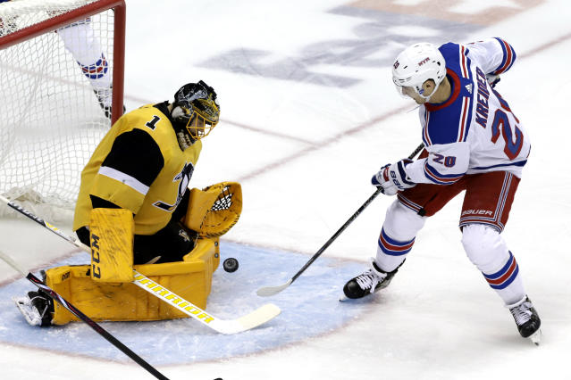New York Rangers' Chris Kreider (20) cannot get a rebound past Pittsburgh Penguins goaltender Casey DeSmith (1) during the first period of an NHL hockey game in Pittsburgh, Sunday, Feb. 17, 2019. (AP Photo/Gene J. Puskar)