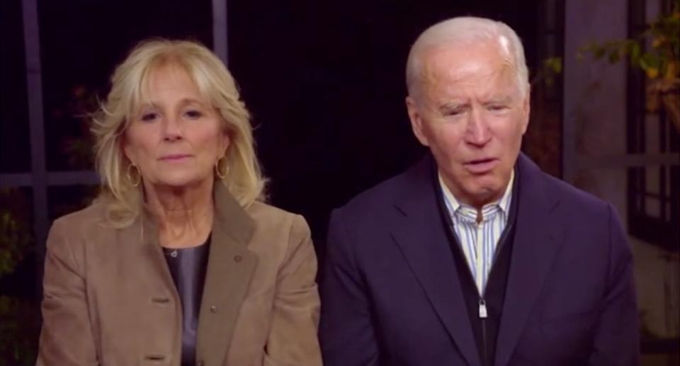 Biden and his wife are seen with concerned faces after his error.