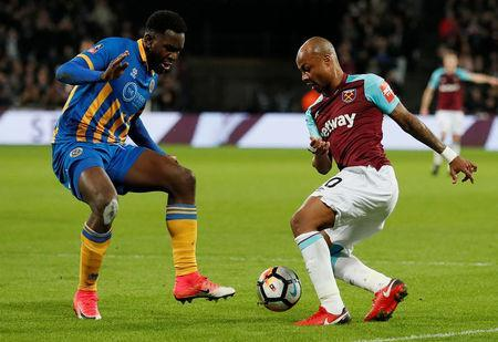 Shrewsbury Town's Aristote Nsiala in action with West Ham United's Andre Ayew. REUTERS/David Klein