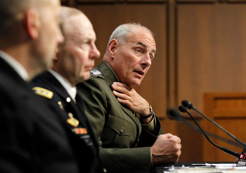 Marine Gen. John F. Kelly, USMC, Commander, U.S. Southern Command, right, accompanied by, from left, Adm. James G. Stavridis, commander, U.S. European Command and Supreme Allied Commander, Europe, and Gen. Charles H. Jacoby, Jr., commander, U.S. Northern Command and Commander, North American Aerospace Defense Command, testifies on Capitol Hill in Washington, Tuesday, March 19, 2013, before the Senate Armed Services Committee hearing on U.S. European Command, U.S. Northern Command, and U.S. Southern Command in review of the Defense Authorization Request for Fiscal Year 2014. (AP Photo/Molly Riley)