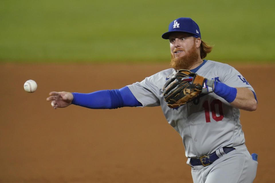 Los Angeles Dodgers' Justin Turner throws in Game 3 of a baseball National League Division Series against the San Diego Padres Thursday, Oct. 8, 2020, in Arlington, Texas. (AP Photo/Sue Ogrocki)