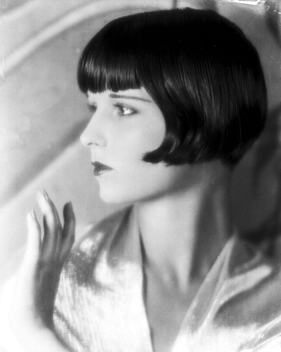 """<p>Here, Louise Brooks shows off her thin eyebrows, bee-stung lips, and <a href=""""http://www.goodhousekeeping.com/beauty/hair/g1813/celebrity-hairstyles-bobs/"""" rel=""""nofollow noopener"""" target=""""_blank"""" data-ylk=""""slk:chic angular bob cut"""" class=""""link rapid-noclick-resp"""">chic angular bob cut</a> with swooping ends that was so popular during the '20s and '30s.</p>"""
