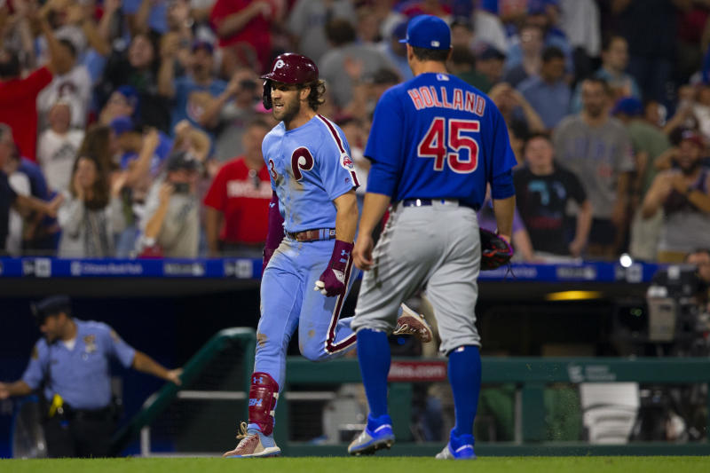 PHILADELPHIA, PA - AUGUST 15: Bryce Harper #3 of the Philadelphia Phillies reacts in front of Derek Holland #45 of the Chicago Cubs after hitting a walk-off grand slam at Citizens Bank Park on August 15, 2019 in Philadelphia, Pennsylvania. The Phillies defeated the Cubs 7-5. (Photo by Mitchell Leff/Getty Images)