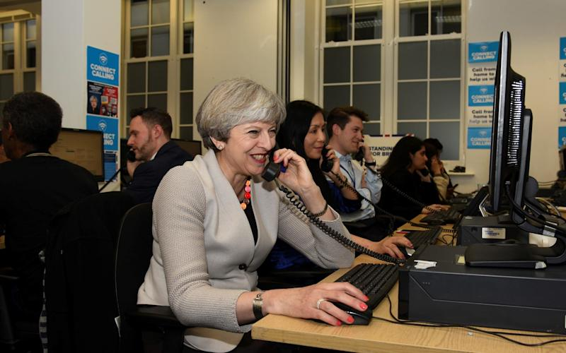 Theresa May visited a Conservative campaign phone bank and spoke to voters on Thursday evening before polls closed - Steve Back Photographer 07884436717 ; steve@steveback.com