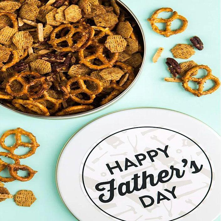 """<p>Give Dad a nice big container of this homemade snack mix he can munch on while he watches the big game. </p><p><em>Get the tutorial at <a href=""""https://sarahhearts.com/snack-mix/"""" rel=""""nofollow noopener"""" target=""""_blank"""" data-ylk=""""slk:Sarah Hearts"""" class=""""link rapid-noclick-resp"""">Sarah Hearts</a>. </em></p>"""