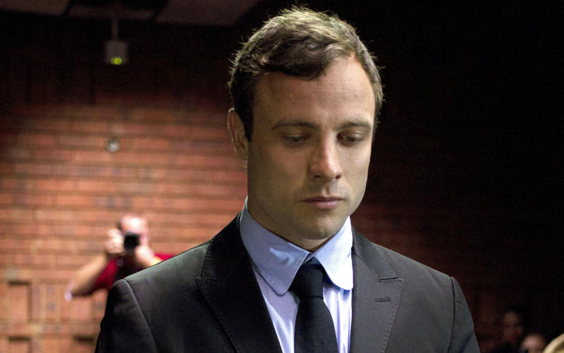 File - In this file photo taken on Monday, Aug, 19, 2013, Oscar Pistorius, the celebrated athlete who became a murder suspect, said Friday, Feb. 14, 2014 that he is consumed by grief on the first anniversary of the day that he fatally shot his girlfriend in his home. (AP Photo/Themba Hadebe, File)
