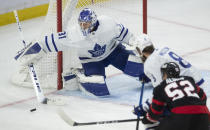 Toronto Maple Leafs goaltender Frederik Andersen deflects the puck wide of the net during the second period of an NHL hockey game against the Ottawa Senators on Wednesday, May 12, 2021, in Ottawa, Ontario. (Adrian Wyld/The Canadian Press via AP)