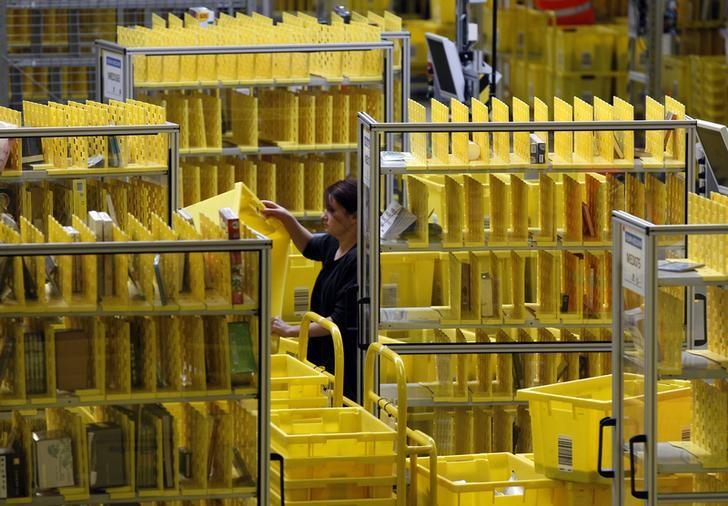 Worker collects items at Amazon's logistics centre in Graben