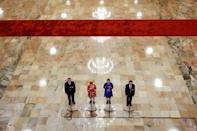 Delegates talk to the media in the Great Hall of the People on the second day of the 19th National Congress of the Communist Party of China in Beijing, October 19, 2017. REUTERS/Thomas Peter