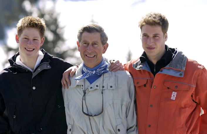<p>A braces-free Harry, 17, smiles for photographers with Charles and William during the family's annual ski trip in Klosters. </p>