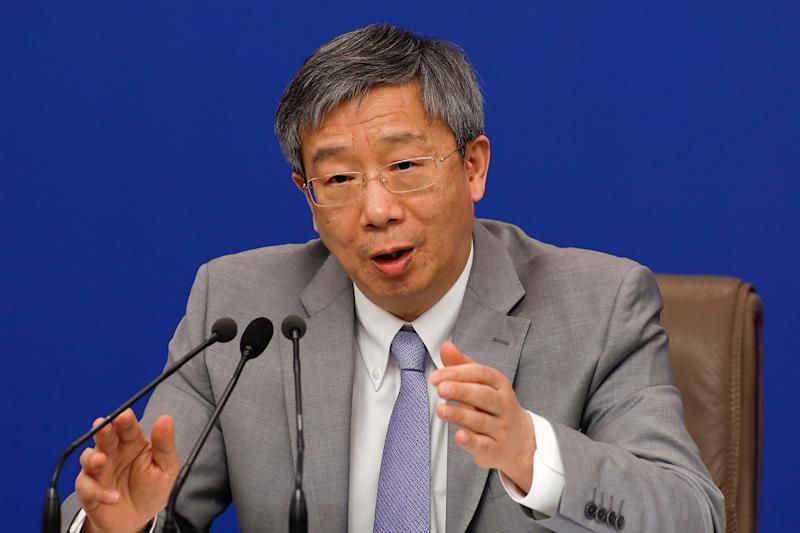China's Central Bank Governor Yi Gang speaks during a press conference on the sideline of the National People's Congress at the media center in Beijing, Sunday, March 10, 2019. (AP Photo/Andy Wong)