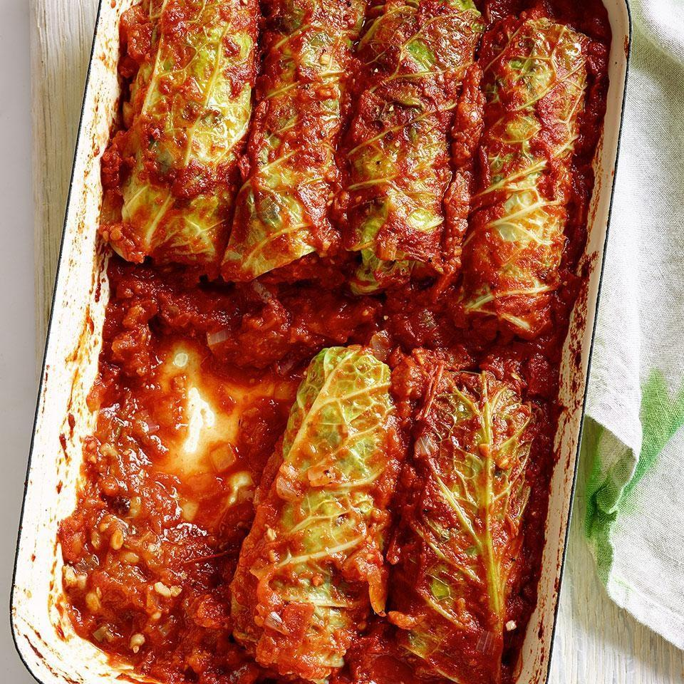 <p>Though traditional stuffed cabbage recipes are made with meat, here Savoy cabbage leaves are stuffed with a combination of rice, mushrooms, onions, garlic and herbs for a healthy vegetarian stuffed cabbage recipe. The stuffed cabbage leaves gently bake in a simple tomato sauce. This easy stuffed cabbage recipe can be made ahead of time and baked just before serving.</p>