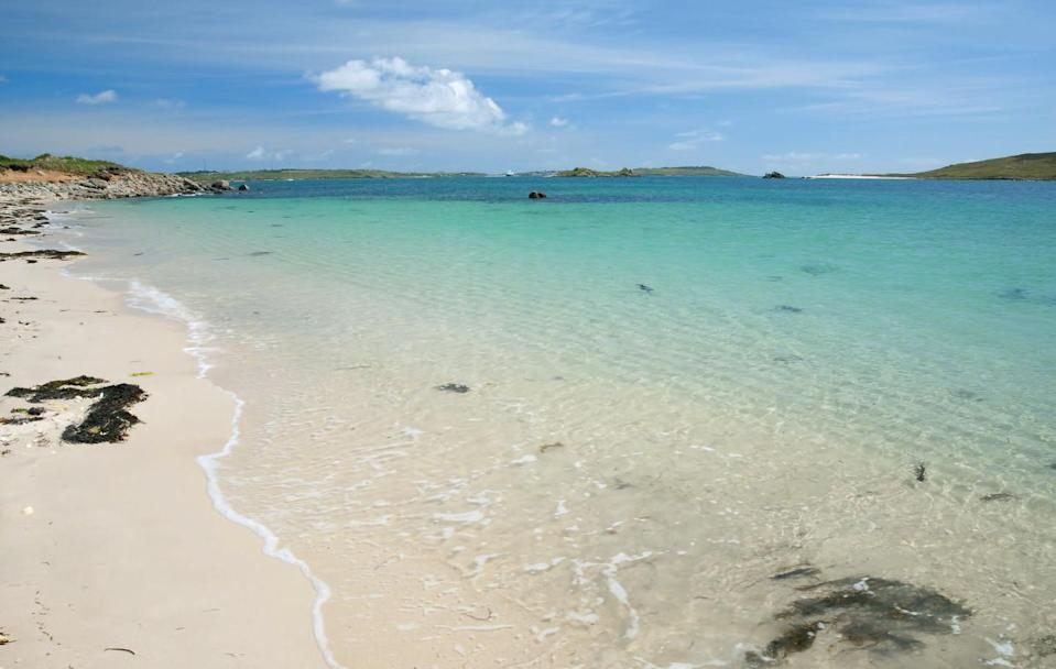 <p>With its azure waters and view over to the uninhabited isle of Samson, Rushy Bay is just the spot to lay out your towel and soak up the sandy surroundings.</p>