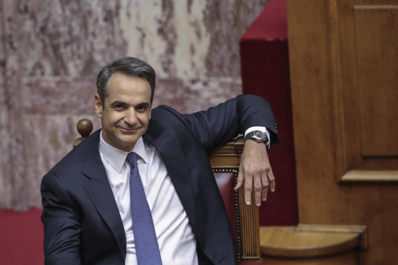 Greece's Prime Minister Kyriakos Mitsotakis smiles during a parliamentary session to present his government's policies in Athens, Saturday, July 20, 2019.(AP Photo/Petros Giannakouris)