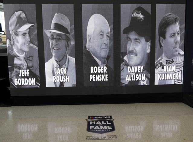 The 2019 class of the NASCAR Hall of Fame, from left, Jeff Gordon, Jack Roush, Roger Penske, Davey Allison and Alan Kulwicki are shown on display after an announcement in Charlotte, N.C., Wednesday, May 23, 2018. (AP Photo/Chuck Burton)