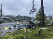 This photo provided by Alicia Jossey shows debris covering the street in East Brewton, Ala., on Saturday, June 19, 2021. Authorities in Alabama say a suspected tornado spurred by Tropical Storm Claudette demolished or badly damaged at least 50 homes in the small town just north of the Florida border. (Alicia Jossey via AP)