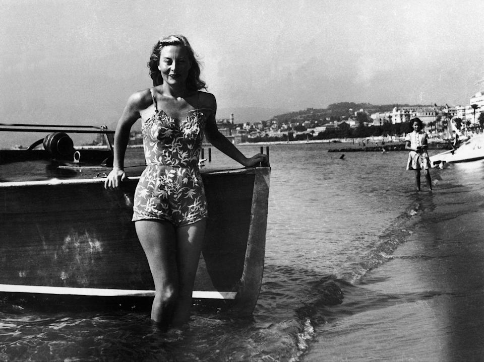 <p>Actress Michele Morgan on the beach at the first Cannes Film Festival in Cannes, France.</p><p>Other celebrity visitors this year: actress Ingrid Bergman, Cary Grant.</p>