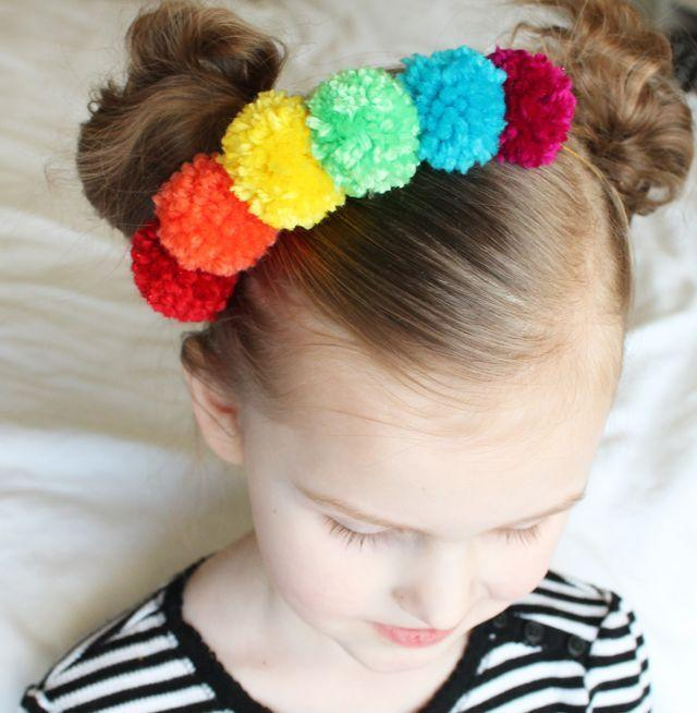 """<p>This colorful headband is perfect for the little kid that loves to accessorize and the parent who has an overflowing craft bin. </p><p><em><a href=""""https://www.sisterssuitcaseblog.com/rainbow-pom-pom-necklace/"""" rel=""""nofollow noopener"""" target=""""_blank"""" data-ylk=""""slk:Get the tutorial at My Sister's Suitcase »"""" class=""""link rapid-noclick-resp"""">Get the tutorial at My Sister's Suitcase »</a></em></p>"""