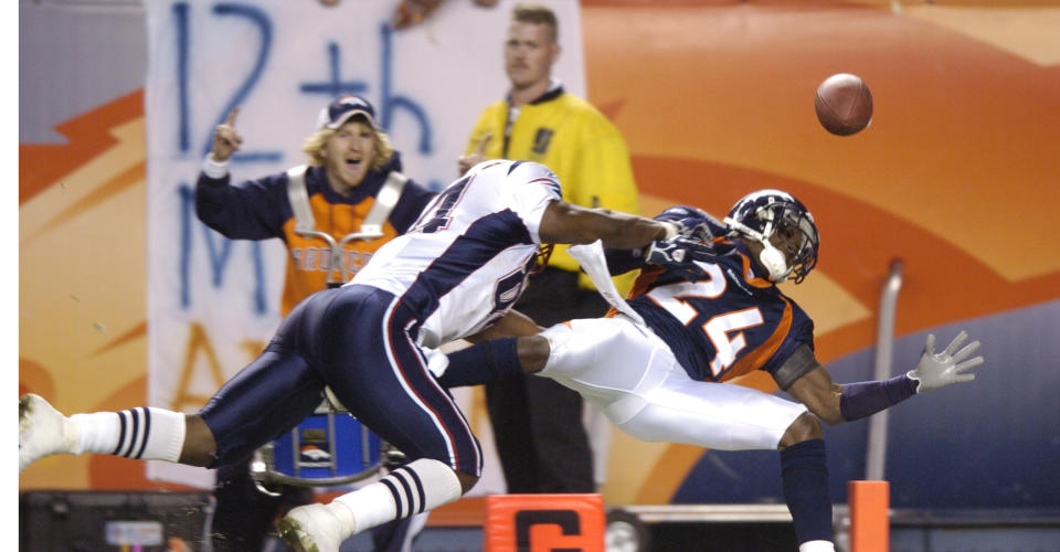 Champ Bailey, right, was hit by the Patriots' Benjamin Watson on the 1-yard line in the 2005 postseason. (Photo By RJ Sangosti/The Denver Post via Getty Images)