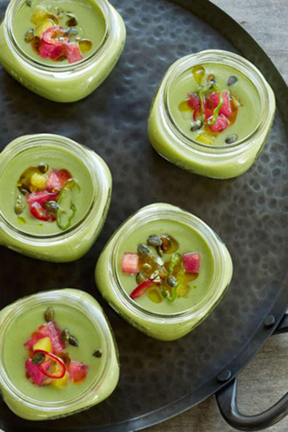 """<p>Refreshingly light and just a little bit sweet and spicy, this cool, colorful soup is a novel twist classic gazpacho.</p><p><strong><a href=""""https://www.countryliving.com/food-drinks/recipes/a5315/cucumber-gazpacho-watermelon-mint-recipe-clx0714/"""" rel=""""nofollow noopener"""" target=""""_blank"""" data-ylk=""""slk:Get the recipe"""" class=""""link rapid-noclick-resp"""">Get the recipe</a>.</strong></p>"""
