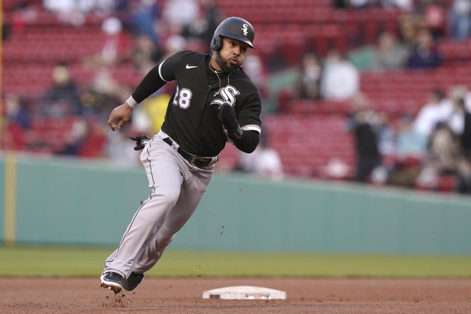 Chicago White Sox's Leury Garcia advances to third base on a double hit by Andrew Vaughn in the sixth inning of a baseball game against the Boston Red Sox, Sunday, April 18, 2021, in Boston. The game is the second of a doubleheader Sunday. (AP Photo/Steven Senne)