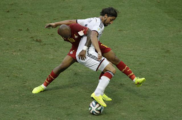 Germany's Sami Khedira, front, controls the ball away from Ghana's Andre Ayew during the group G World Cup soccer match between Germany and Ghana at the Arena Castelao in Fortaleza, Brazil, Saturday, June 21, 2014. (AP Photo/Themba Hadebe)