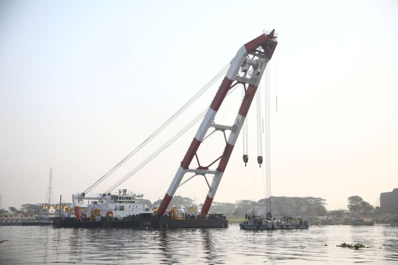 A rescue ship is seen at the site where several people died after a ferry collided with a cargo vessel and sank on Sunday in the Shitalakhsyaa River in Narayanganj