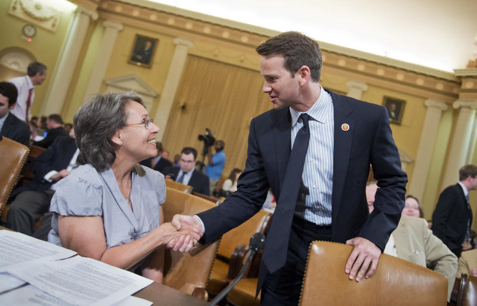 UNITED STATES - JUNE 04: Sue Martinek of the Coalition for Life of Iowa, talks with Rep. Aaron Schock, R-Ill., before a House Ways and Means Committee hearing in Longworth Building to investigate the IRS's scrutiny of politically based groups. Witnesses included leaders of conservative political groups. (Photo By Tom Williams/CQ Roll Call)