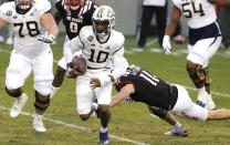 Georgia Tech quarterback Jeff Sims (10) escapes North Carolina State linebacker Payton Wilson (11) as he gains yards during the first half of an NCAA college football game in Raleigh, N.C., Saturday, Dec. 5, 2020. (Ethan Hyman/The News & Observer via AP, Pool)