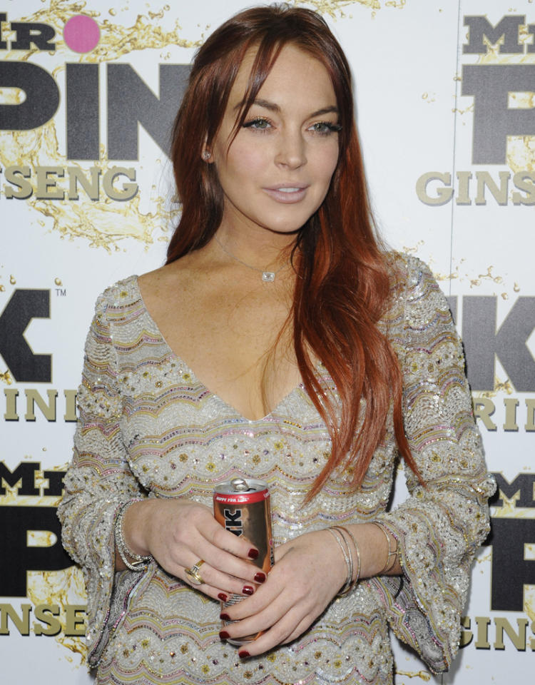 Lindsay Lohan tops the list along with La Toya, Prince, Paris and Blanket Jackson as Mr. Pink Ginseng Drink, the hottest new wellness beverage, launches at the prestigious Beverly Wiltshire Hotel in Beverly Hills, California. Pictured: Lindsay Lohan Ref: SPL446337  111012  Picture by: Rob Latour for London Entertainment / Splash News   Splash News and Pictures Los Angeles:310-821-2666 New York:212-619-2666 London:870-934-2666 photodesk@splashnews.com