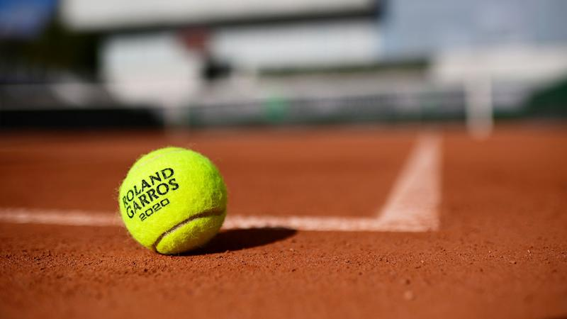 A solitary tennis ball can be seen here resting on the clay at Roland Garros.