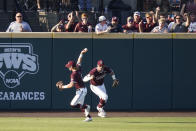Mississippi State outfielder Rowdey Jordan, left, celebrates after catching a Notre Dame fly ball for an out while teammate Brad Cumbest, right, pumps his fist during an NCAA college baseball super regional game, Monday, June 14, 2021, in Starkville, Miss. (AP Photo/Rogelio V. Solis)