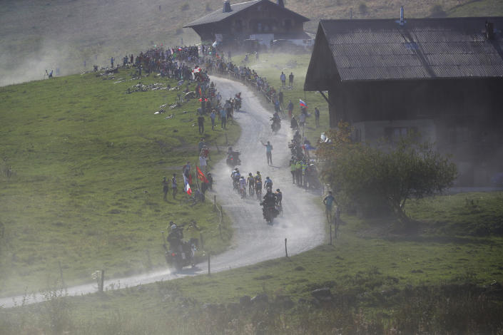 FILE - In this Sept.17, 2020 file photo, riders with Slovenia's Primoz Roglic, wearing the overall leader's yellow jersey, and Slovenia's Tadej Pogacar, wearing the best climber's dotted jersey, climb Plateau des Glieres during stage 18 of the Tour de France cycling race over 175 kilometers (108.7 miles) from Meribel to La Roche-sur-Foron, France. (AP Photo/Thibault Camus, File))