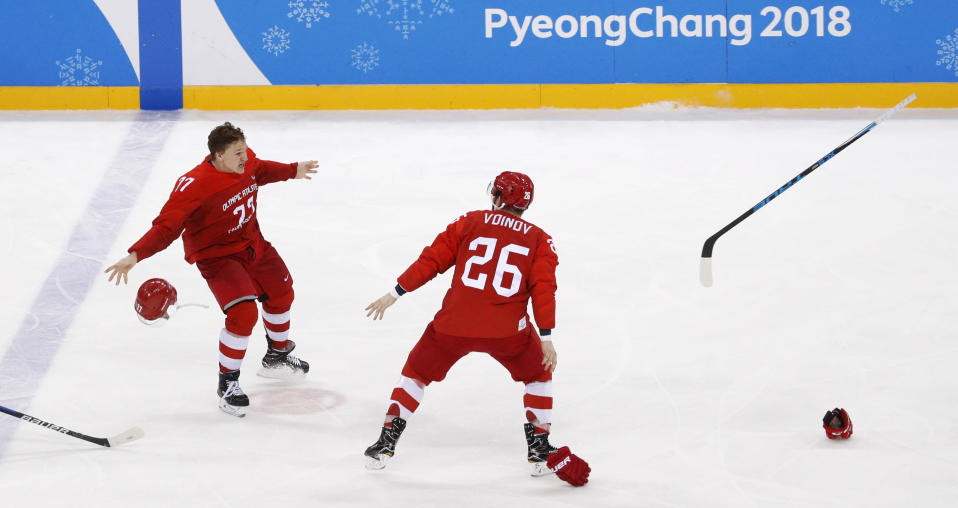 Russian athlete Kirill Kaprizov (77) and Vyacheslav Voynov (26) celebrate after winning the men's gold medal hockey game against Germany, 4-3. (AP)