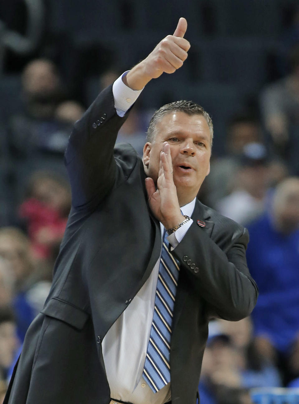 Creighton coach Greg McDermott directs his team against Kansas State during the first half of a first-round game in the NCAA men's college basketball tournament in Charlotte, N.C., Friday, March 16, 2018. (AP Photo/Bob Leverone)