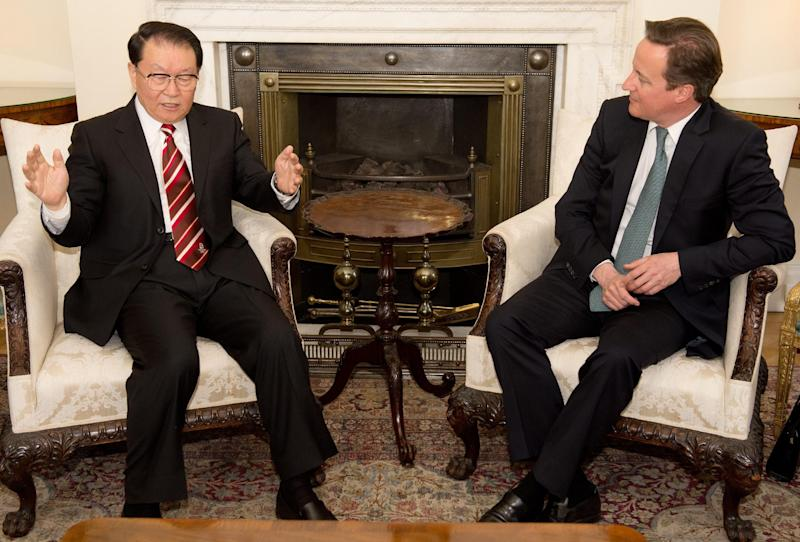 Chinese Communist Party official Li Changchun, left, speaks  with British Prime Minister David Cameron, during their meeting at Downing Street in central London on  Tuesday April 17, 2012. (AP Photo/Leon Neal. Pool)