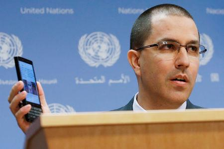 FILE PHOTO: Venezuela Minister of Foreign Affairs Jorge Arreaza displays his cellular device as he delivers remarks in the press briefing room at the United Nations Headquarters in New York, U.S. February 12, 2019. REUTERS/Andrew Kelly/File Photo